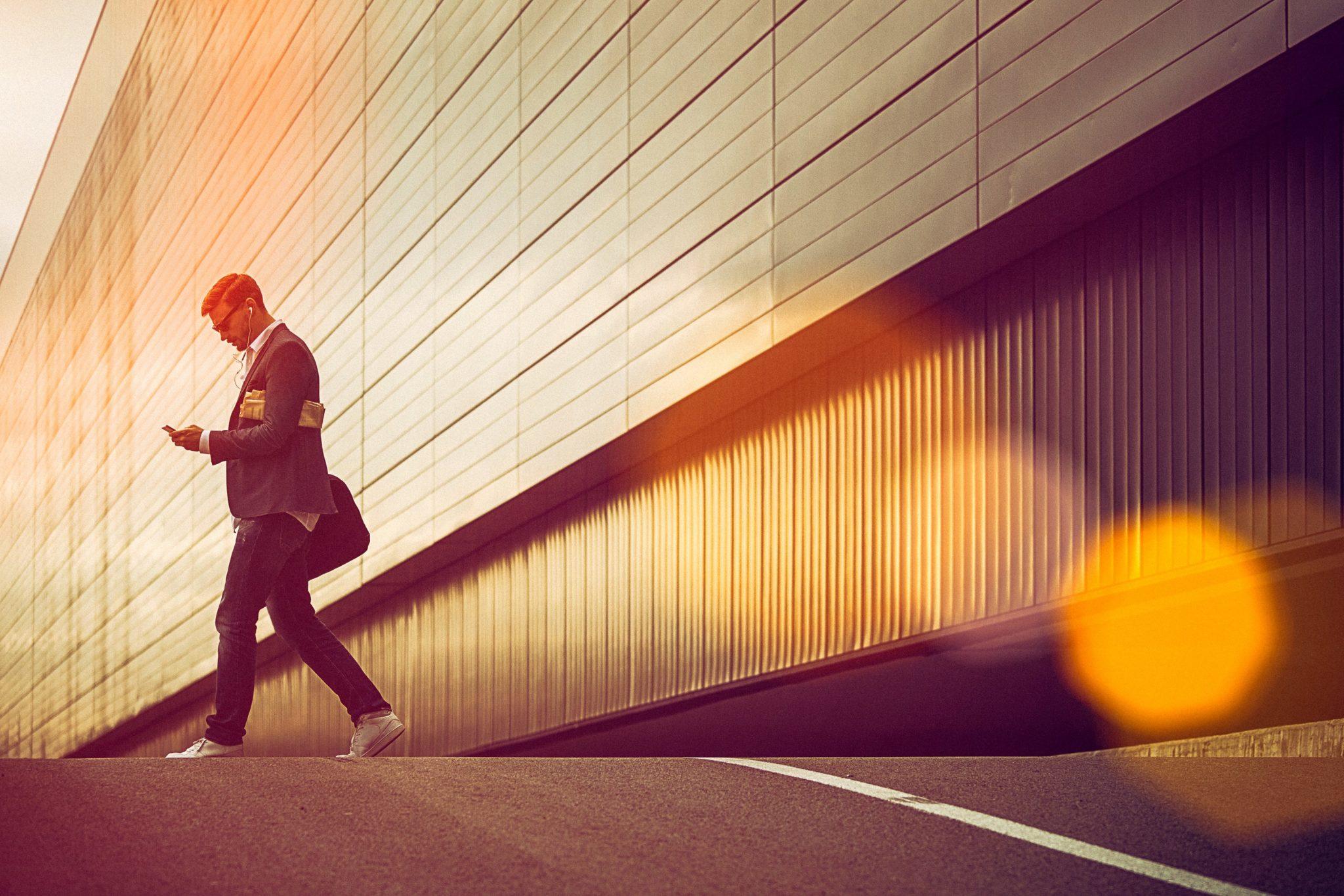 GEN_person_walking_smartphone